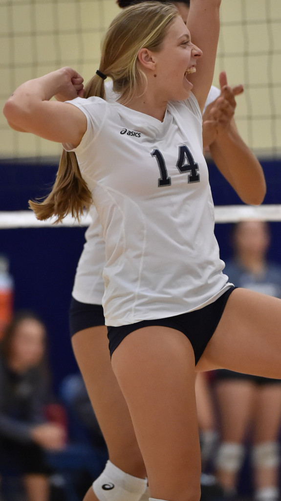 In the match of women's volleyball between Irvine Valley College and Fullerton College on Friday night, guest team player Kayla Scheevel celebrates a spike victory over the host team.