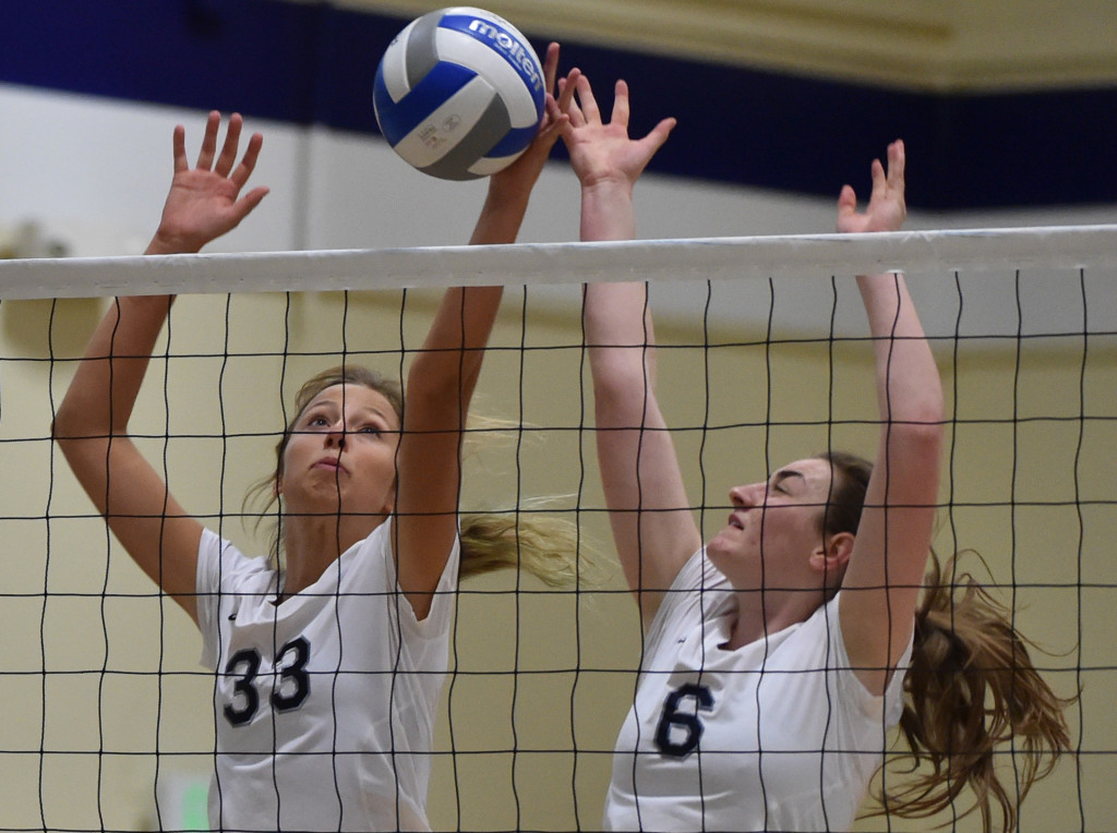 In the match of women's volleyball between Irvine Valley College and Fullerton College on Friday night, guest team player Hannah Matt and Hailey Riden try to block the offence from the host team.